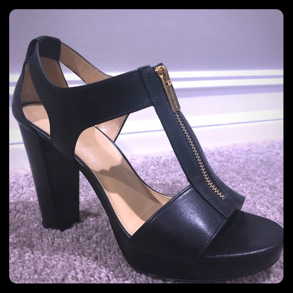 8295f56fc23 Michael Kors block heel. M 5be606412beb798f9aec5d0d. Other Shoes you may  like. Black patent black leather heel